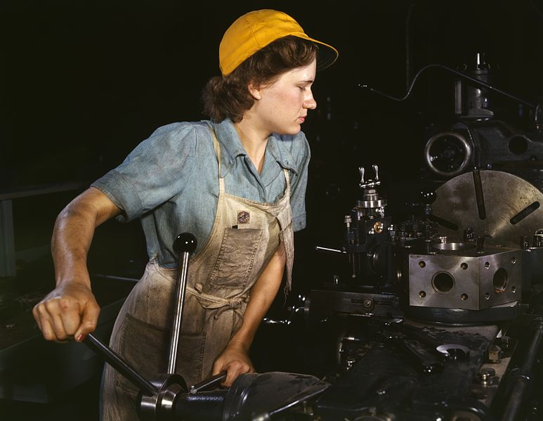 Turret lathe operator machining parts for transport planes at the Consolidated Aircraft Corporation plant in Fort Worth, Texas, 1942.